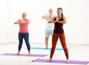 Group of mature people at yoga