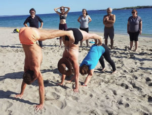 Yoga handstands in a line