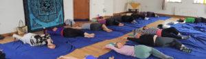 Ladies on mats doing yoga