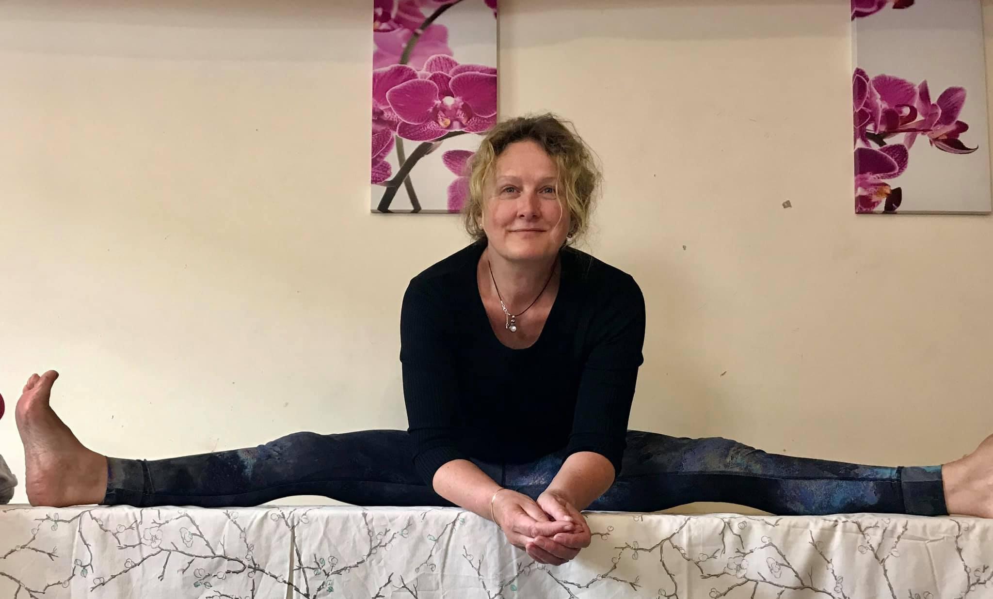 Christine Stewart in yoga pose