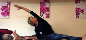 Christine doing wide legged side fold yoga
